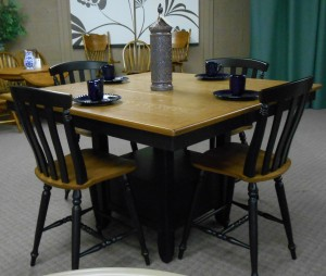 table with black chairs